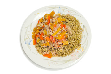 Green noodles topped with pork, carrots, pumpkin