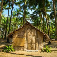 Straw hut on Paradise beach in Goa, India
