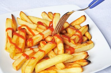 French fries with tomato sauce © Arena Photo UK