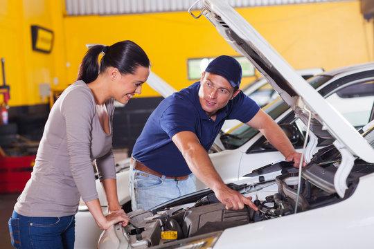 mechanic showing customer car problem