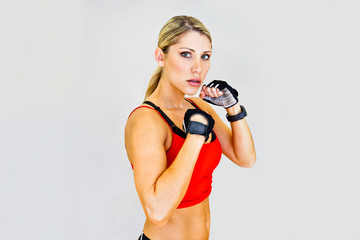 woman boxer, aggressive and looks at the camera