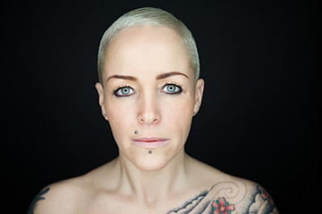 beautiful woman with short hair and tattoos