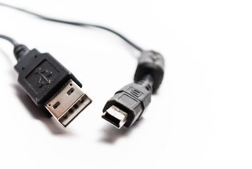 Two cables with plugs known for all USB and mini-USB