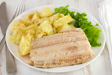 boiled fish with potato and lettuce