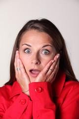 Brunette in red loooking surprised