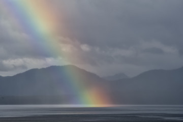 A rainbow going down on the Alaskan Sea