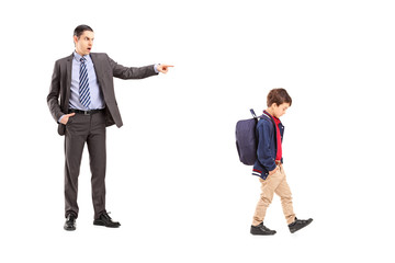Full length portrait of an angry father shouting at his son
