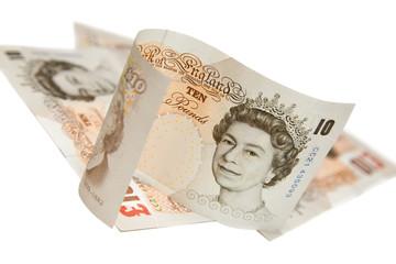Ten pounds notes on white