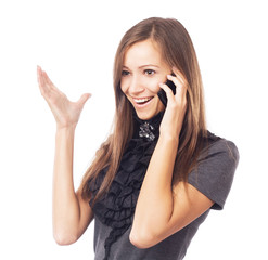 Young joyful woman talking on mobile phone