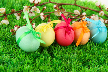 Colorful eastern eggs on  grass background