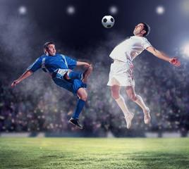 Spoed Fotobehang Voetbal two football players striking the ball
