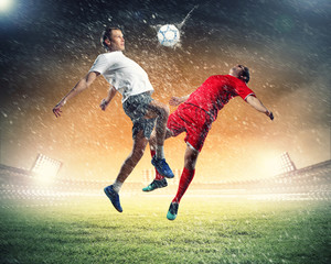 Printed kitchen splashbacks Football two football players striking the ball