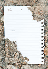 White paper on dirty ground