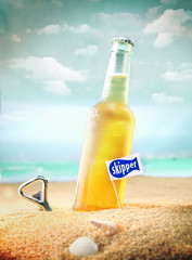 Chilled fruity soda or ale on the beach