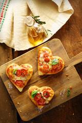 Cute heart shaped mini pizzas
