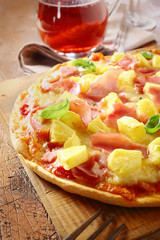 Appetising ham and pineapple Italian pizza
