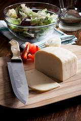 Cheese adn salad. Dark tone