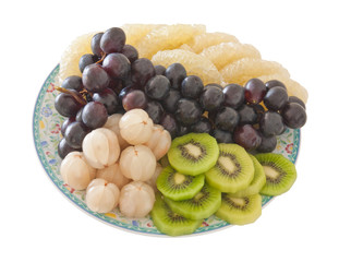 Plate of mixed fruits, isolated on white background