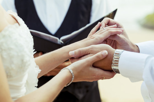 Hands newly married about wedding rings