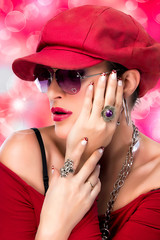 Fashionable Hip Hop Girl. Beauty Brunette with Red Cap.