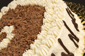 Close up of a cream and chocolate cake