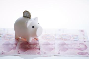 piggy bank on china dollar banknote