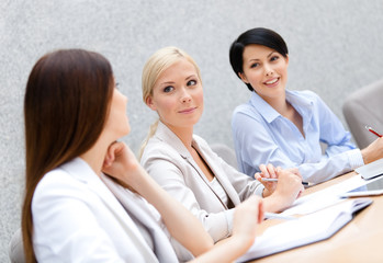 Female colleagues discuss business plan
