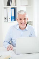 Smiling Businessman Working