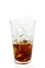 Cola glass with ice cubes over white