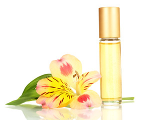 Women's perfume in beautiful bottle with flower isolated
