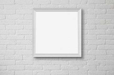 Blank picture frame at the wall with clipping path