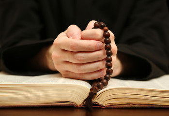 Priest reading from the holy bible, close up