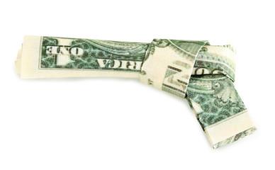 Dollar folded into gun isolated on white
