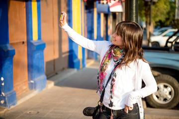 Girl doing an urban self portrait