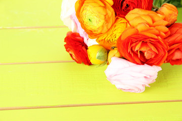 Ranunculus (persian buttercups), ongreen wooden background