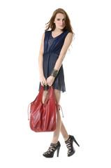 Full portrait of young stylish woman with handbag posing