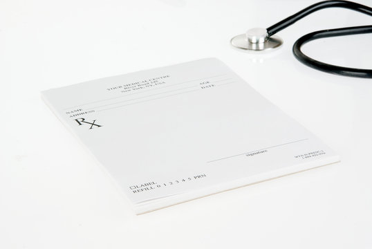 Stethoscope and empty prescription isolated