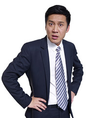 studio portrait of asian businessman, arms akimbo