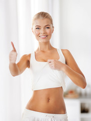 sporty woman showing thumbs up