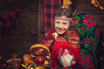 Russian beauty girl in a wooden interior