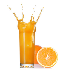 Deurstickers Opspattend water splash of juice in the glass with orange isolated on white