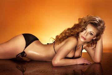 Beautiful woman with perfect body posing in swimwear.