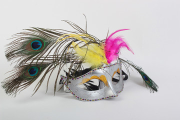 Carnival mask with feathers of a peacock