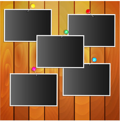 photos attached stationery pins to wooden wall