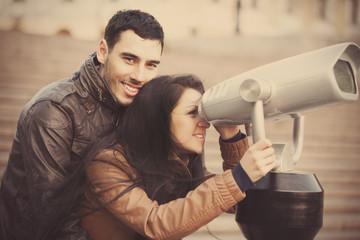 Couple viewing in binocular.