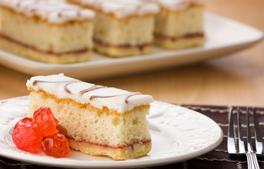 Sliced Cherry Bakwell Cake With Glazed Cherries.