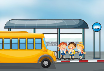 A yellow school bus and the three kids