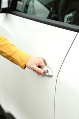 Woman hand opening car door, close up