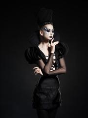 beautiful model posing as chess queen - fashion & beauty concept