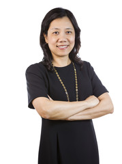 Mature Asian Woman in Business attire standing relaxed